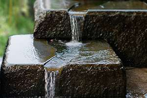 Upgrade the Look and Feel of Your Backyard with a Pondless Waterfall